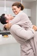 Man lifting and hugging his partner in the morning