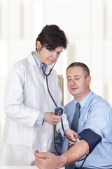 Doctor measures the blood pressure in patients