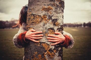Woman hugging a tree