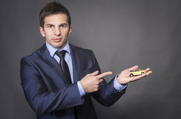 Businessman Holding Toy Car