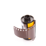 35mm still camera film cartridge over white background