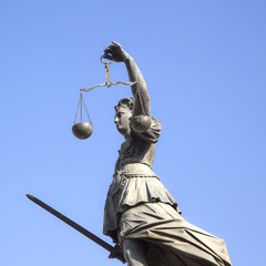 Statue of Lady Justice in front of the Romer in Frankfurt