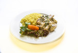 liver in sour cream sauce with rice and vegetables
