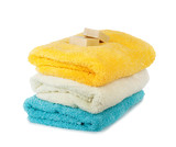 Stack of fresh clean towels and scented soap isolated on white b