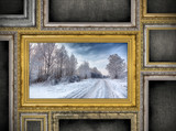 golden wooden frame with beautiful landscape among other empty f