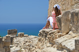Girl among ancient ruines of Kourion in Cyprus