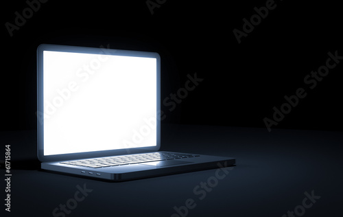 laptop on dark background