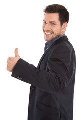 Erfolgreicher lachender Geschäftsmann freigestellt mit Daumen