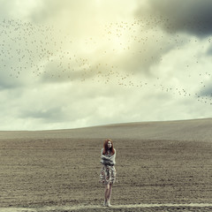 Art portrait of a lonely girl in a field