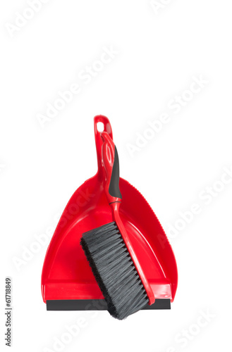 red dustpan with brush on it