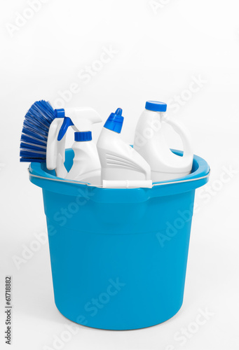 cleaning supplies in bucket on white background