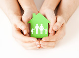 hands holding green house with family - Fine Art prints