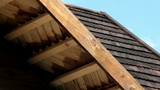 The cedar wooden shingle roof of the house shake