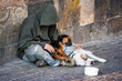 Leinwandbild Motiv beggar with two Dogs near Charles Bridge, Prague