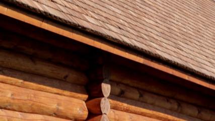 Brown colored log house wall with tar oiled cedar