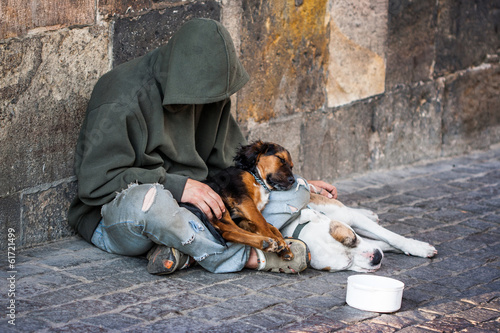 Poster beggar with two Dogs near Charles Bridge, Prague