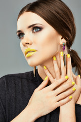 Yellow nails and lips. Beauty woman