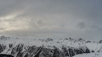 Tirol snow covered mountains bad weather time lapse