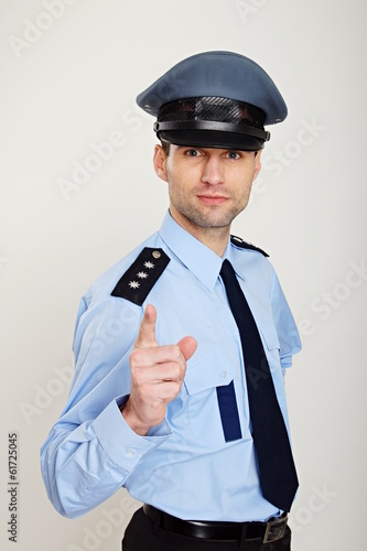 Policeman shows with his finger on you