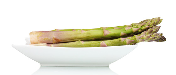 delicious fresh asparagus on a plate isolated on white