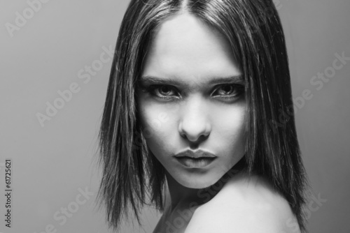 black and white photo portrait of a beautiful young girl with a