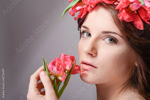 Fresh photo fashion model with great hair and flowers in her hai