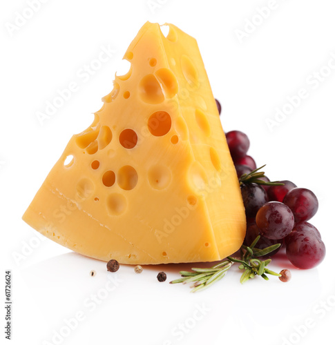 Piece of cheese with grape and rosemary, isolated on white