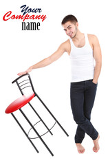 Handsome young man with chair isolated on white