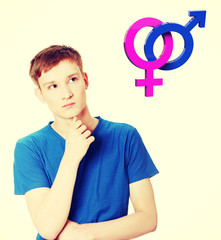 Young man thinking about heterosexual relationship