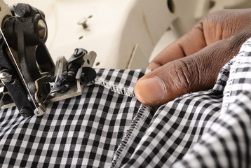 Close up of an employee working on an industrial sewing machine