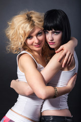 Two young attractive lesbians are hugging