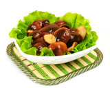 Marinated mushrooms with lettuce leaves.