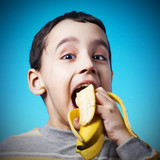 Boy eating bananas