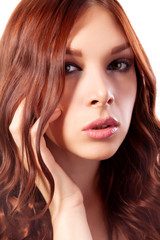 Portrait of young woman with red hair