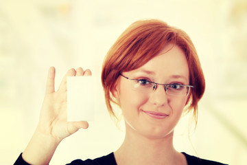 Redhead female person with blank business card