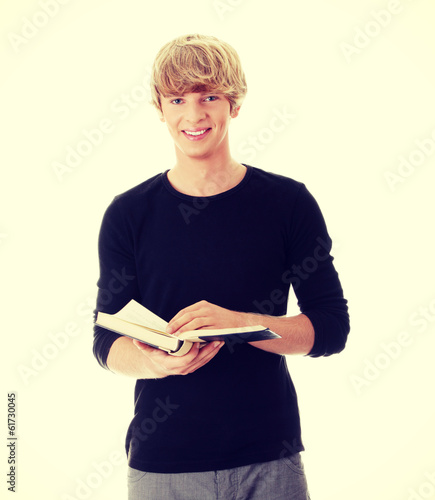 Teen man reading book