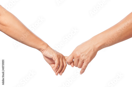 man and woman hook finger together