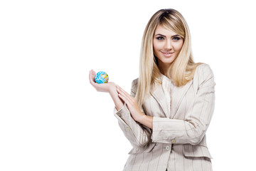 Woman holding a world globe and  dreaming about traveling. Busin