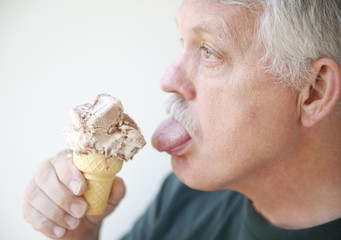 Man licks ice cream cone