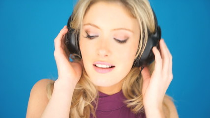 Beautiful blond woman concentrating on her music
