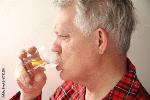 Ill man with soothing drink