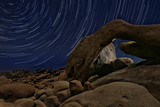 Night Star Trail Streaks over the Rocks of Joshua Tree Park