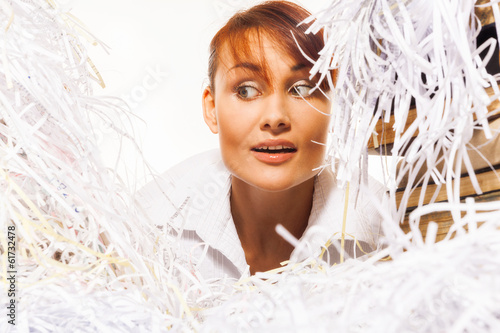 Young woman with shredded paper