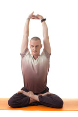 Image of middle-aged man posing in lotus posture