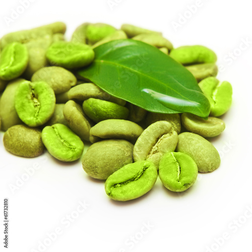 Green coffee beans with leaf on white background.