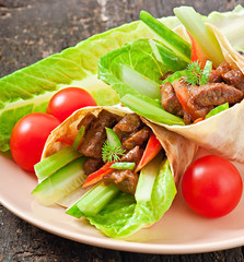 Tortilla wraps with meat and fresh vegetables