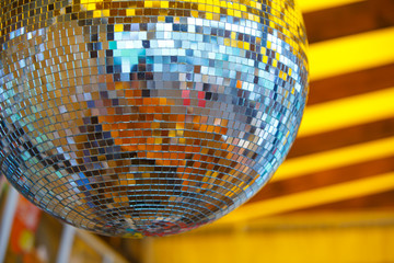 disco ball in yellow background