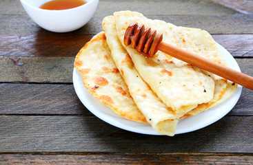 thin pita bread with honey