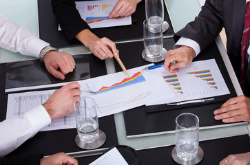 Businesspeople Discussing Plan In Office