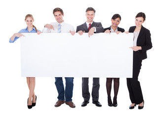 Businesspeople Holding Blank Board